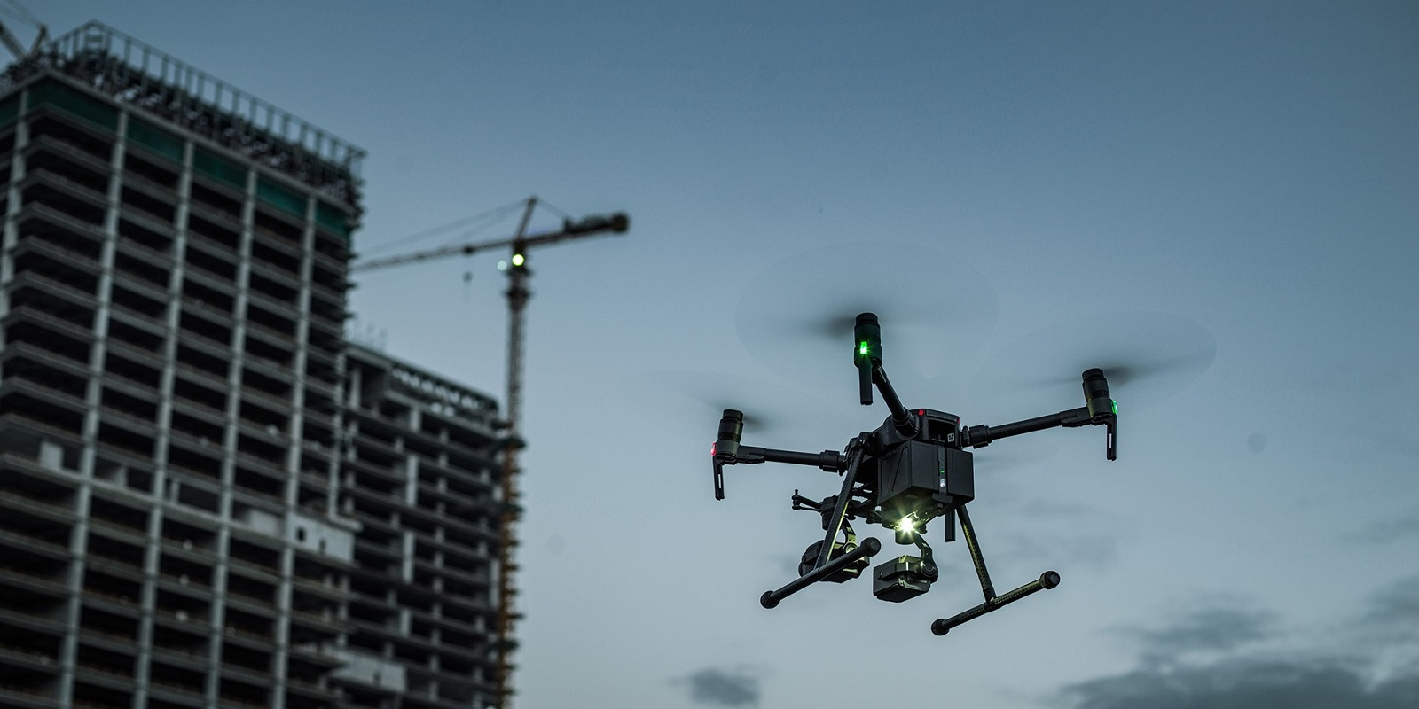 Drone flying near a building under construction